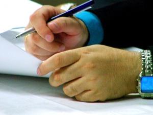 20090925181915-firma-contrato.jpg